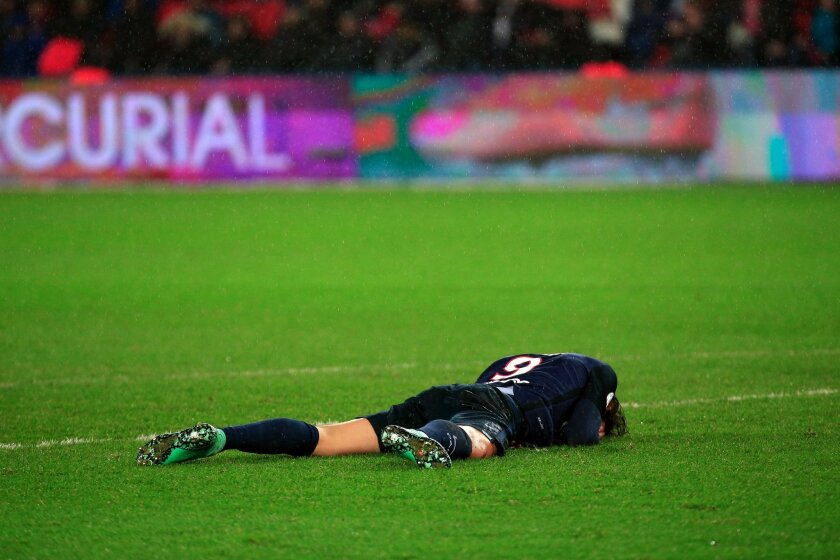 PSG's Edinson Cavani lays down on the pitch during his League One soccer match against Lille, at the Parc des Princes stadium, in Paris, Saturday, Feb. 13, 2016. (AP Photo/Thibault Camus)