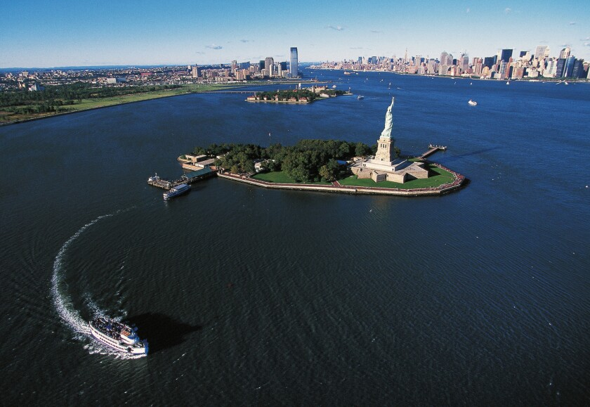 Liberty Island with Ellis Island and Manhattan in the background.