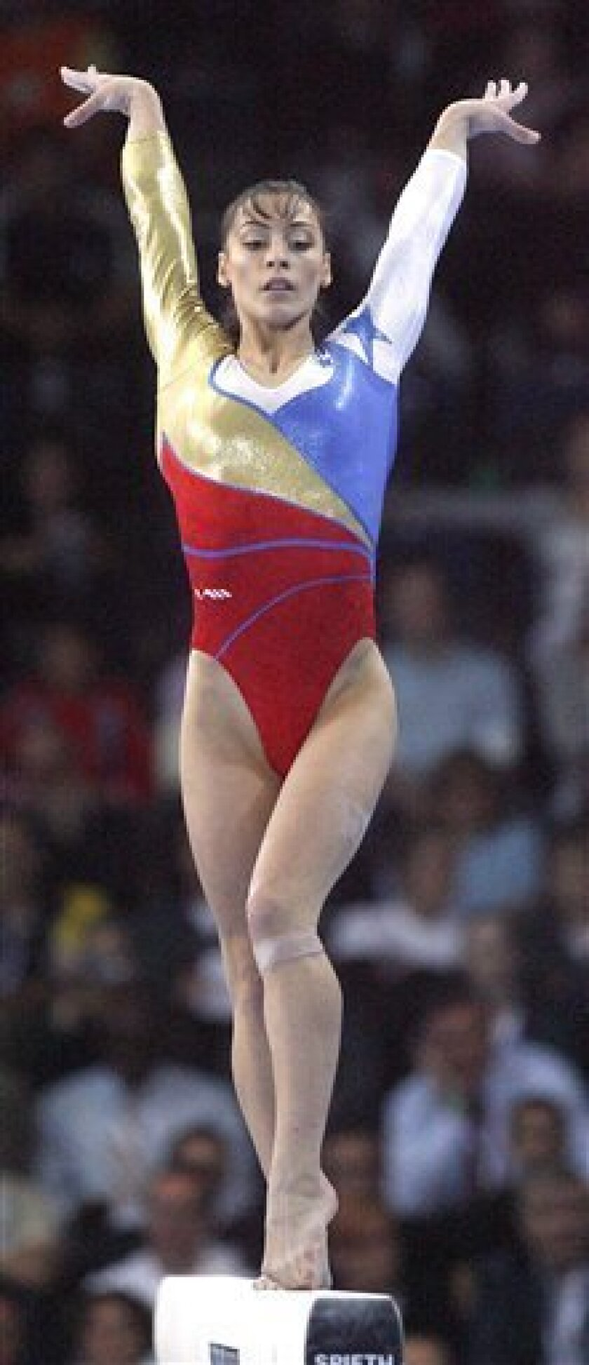 FILE - This Sept. 5, 2007, file photo shows gymnast Catalina Ponor, of Romania, competing on the beam during the women's team final of the Gymnastics World Championships, in Stuttgart, Germany. Back in her element after deciding she's not cut out for the sedate life of a retiree, the 24-year-old is giving the Romanians some badly needed swagger as they rebuild their once-proud women's program. (AP Photo/Michael Sohn, File)