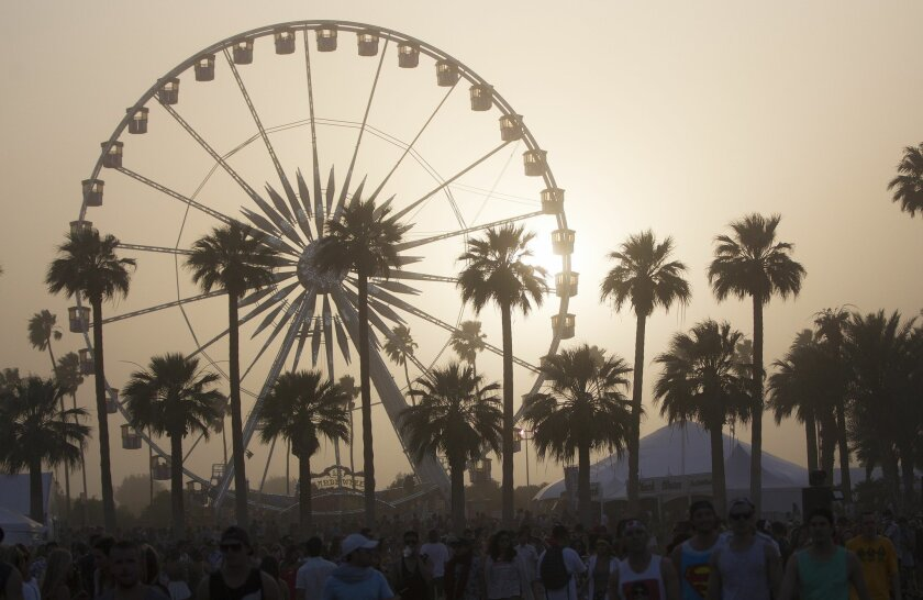 On the second day of the Coachella Valley Music and Arts Festival a sold partied in windy dusty weather. In the early afternoon, the wind picked up, stirring dust into the air Saturday.