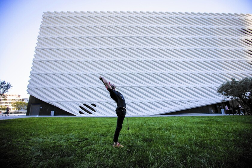Blakey Olsen, of Laguna Beach, practices yoga in the shade on the cool grass lawn of the Broad Museum in downtown Los Angeles, where Tuesday's high of 89 set a record for the date.