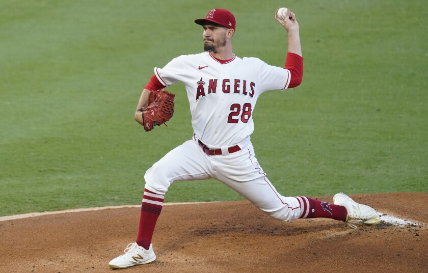 Angels starting pitcher Andrew Heaney throws during the first inning of a 4-3 win over the Texas Rangers.