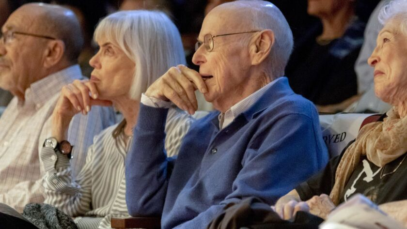 """Retired U.S. District Court Judge H. Lee Sarokin, center, and his wife, Margie, second from left, watch the reading of his latest play """"The Protester"""" at North Coast Repertory Theatre on Monday."""