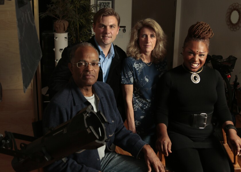 """Jazzmun Nichcala Crayton, right, with, from left, director Michael Brewer and co-executive producers David Hays Gaddis and Madeleine Liebert of the documentary """"In Full Bloom."""""""