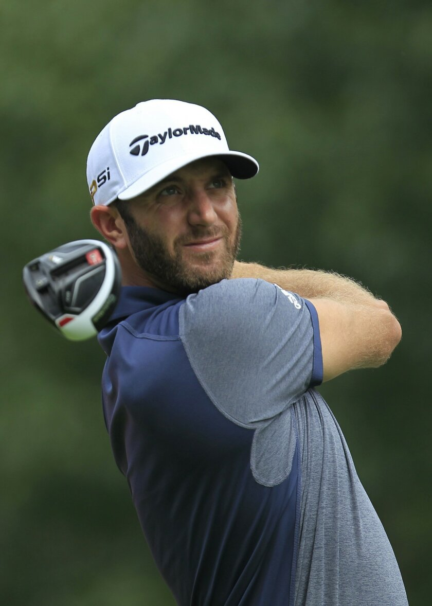Dustin Johnson of the United States tees off on the 14th hole during the first round of the HSBC Champions golf tournament at the Sheshan International Golf Club in Shanghai, China Thursday Nov. 5, 2015. (AP Photo)