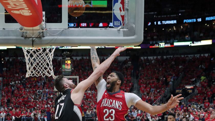 New Orleans Pelicans forward Anthony Davis (23) shoots against Portland Trail Blazers center Jusuf N