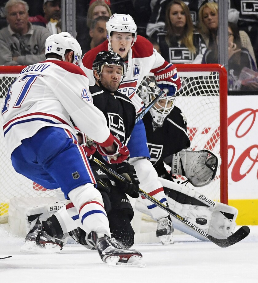 Canadiens right wing Alexander Radulov, left, scores on Kings goalie Peter Budaj, right, as defenseman Alec Martinez tries to stop the shot and Canadiens right wing Brendan Gallagher positions himself in front during the second period.