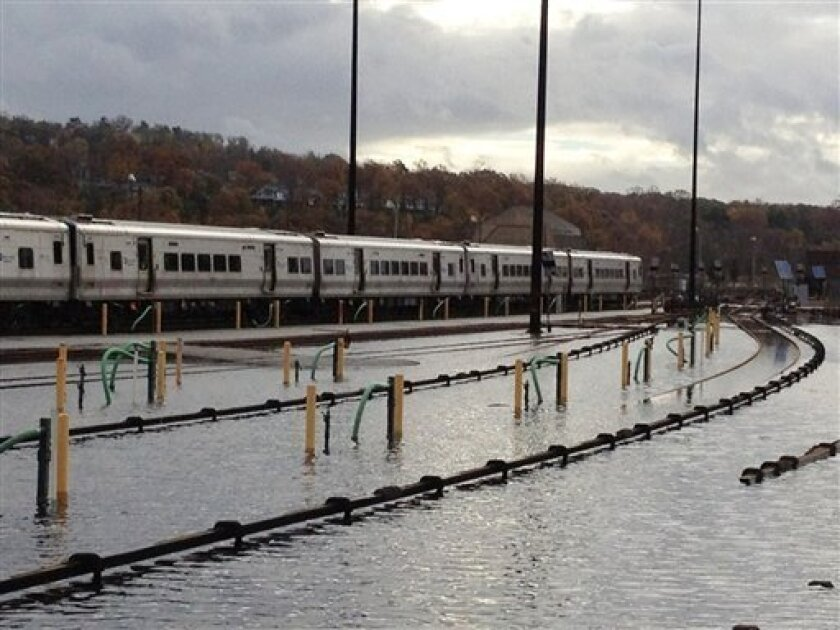 In a photo made available by the Metropolitan Transportation Authority, trains stand in a flooded Metro-North's Harmon Yard, Wednesday morning, Oct. 31, 2012, on the Hudson Line, in Croton-on-Hudson, New York in the aftermath of superstorm Sandy. (AP Photo/Metropolitan Transportation Authority)