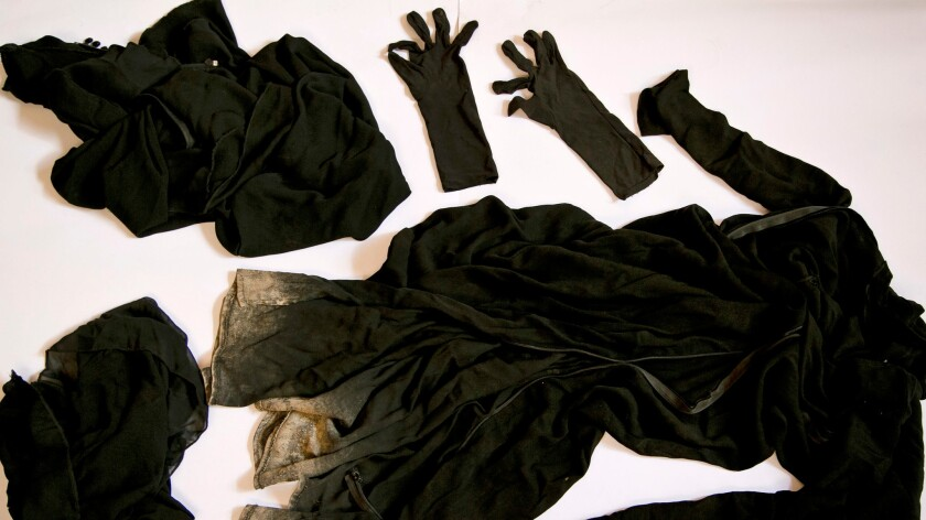 Clothing worn by a Yazidi girl enslaved by militants, collected by a Yazidi activist to document Islamic State group crimes against the community.
