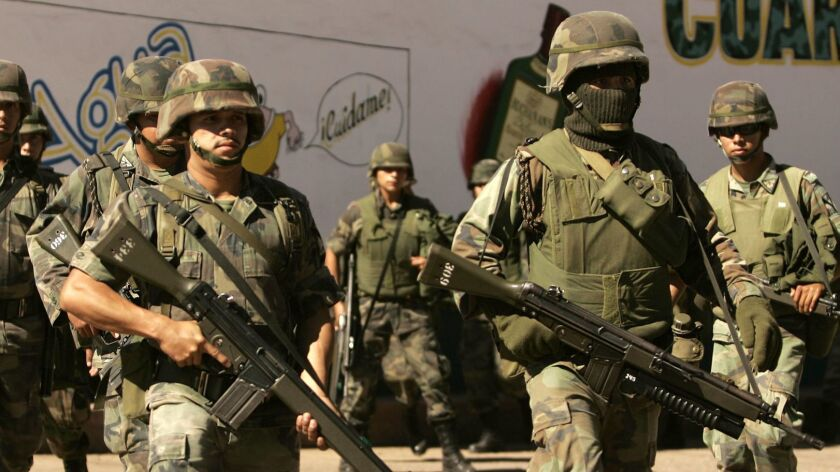 Mexican soldiers patrol the state of Michoacan in 2006, the year Mexico first deployed the military to fight against drug cartels.