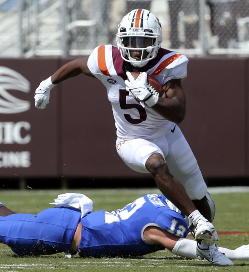 Virginia Tech running back Raheem Blackshear (5) escapes Middle Tennessee safety Reed Blankenship (12) in the first half of an NCAA college football game, Saturday, Sept. 11, 2021, in Blacksburg Va. (Matt Gentry/The Roanoke Times via AP)