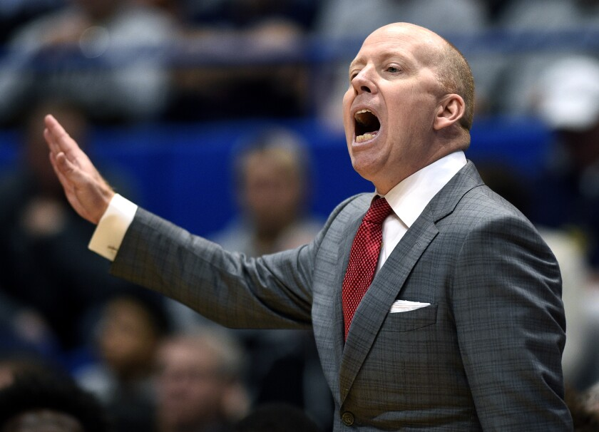Mick Cronin shouts instructions to his players during a game.