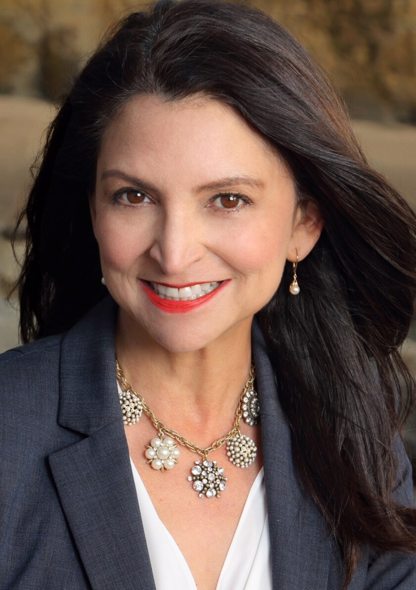 Real estate agent Rosamaria Acuña of Berkshire Hathaway HomeServices California Properties' La Jolla office on Prospect