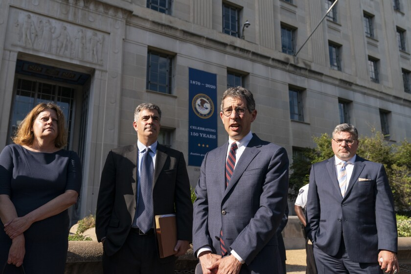 Bruce Brown, third from left, executive director of the Reporters Committee for Freedom of the Press, speaks accompanied by Washington Post Executive Editor Sally Buzbee, left, Washington Post general counsel Jay Kennedy, CNN executive vice president and general counsel David Vigilante, right, after a meeting with Attorney General Merrick Garland at the Department of Justice, Monday, June 14, 2021, in Washington. (AP Photo/Alex Brandon)