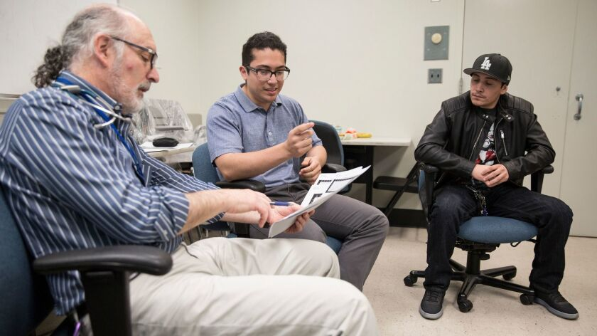 LOS ANGELES, CALIF. -- FRIDAY, MARCH 17, 2017: Dr. Marc Weigensberg, left, leads a group session wit