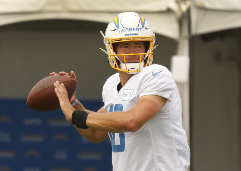 Chargers quarterback Justin Herbert prepares to throw during a practice.