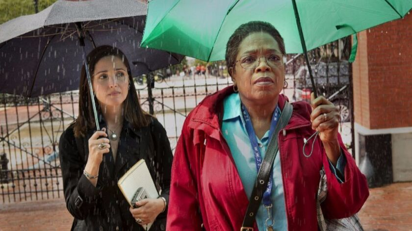 """Rose Byrne, left, and Oprah Winfrey in HBO's """"The Immortal Life of Henrietta Lacks."""""""