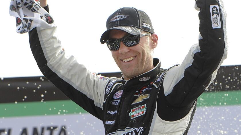 Kevin Harvick celebrates after winning Saturday's NASCAR Xfinity Series race at Atlanta Motor Speedway.