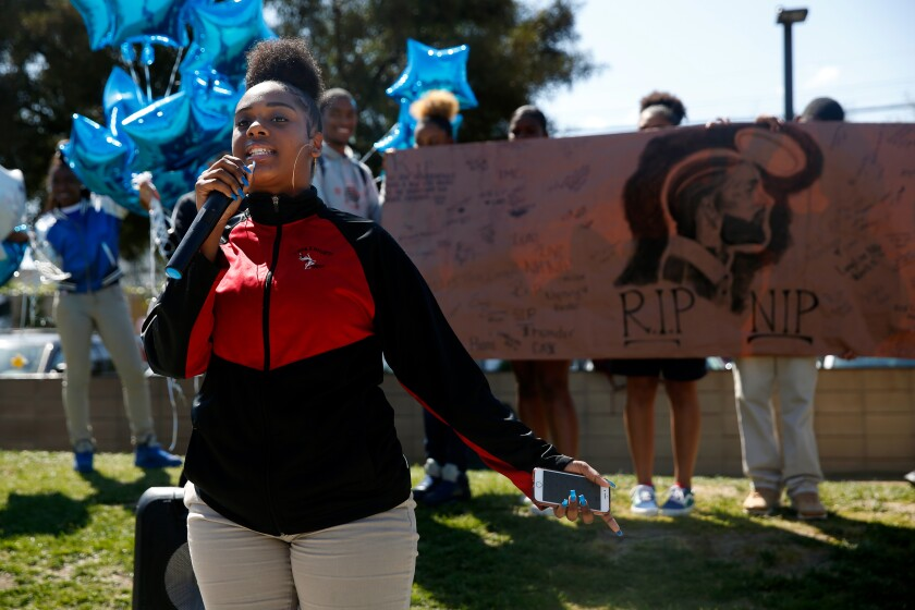 amryn Johnson raps during a memorial event for Nipsey Hussle