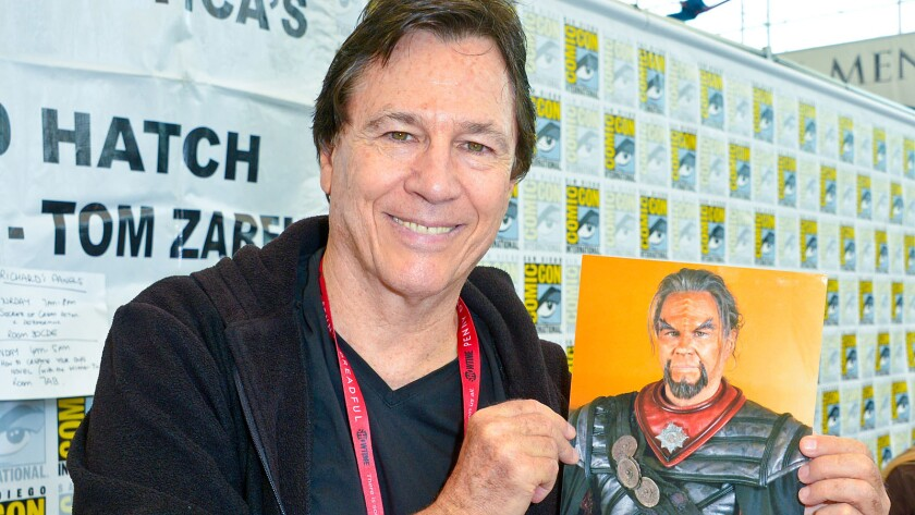 """Actor Richard Hatch signs autographs of himself dressed as a Klingon in the fan film """"Star Trek Axanar"""" at Comic-Con."""