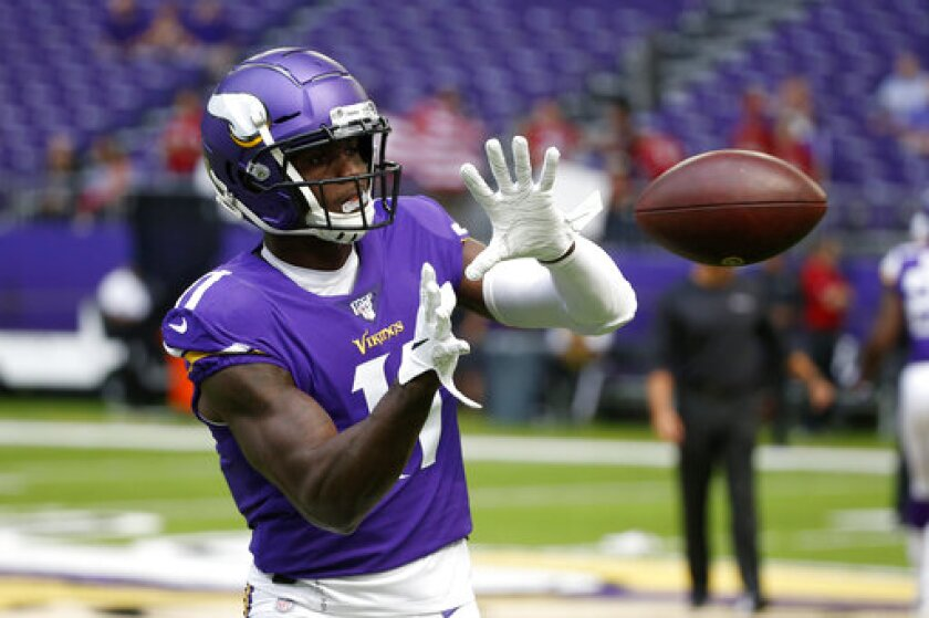 In this Aug. 24, 2019, photo, Minnesota Vikings wide receiver Laquon Treadwell warms up before an NFL preseason football game against the Arizona Cardinals in Minneapolis. The Vikings have brought back a pair of familiar players, signing cornerback/punt returner Marcus Sherels and wide receiver Treadwell. (AP Photo/Bruce Kluckhohn)