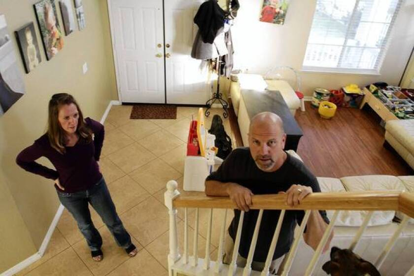 """Because of a prior foreclosure, Michele and Russell Poland turned to a subprime mortgage to buy their current home. """"It was expensive, but we think it's worth it,"""" Russ Poland said."""