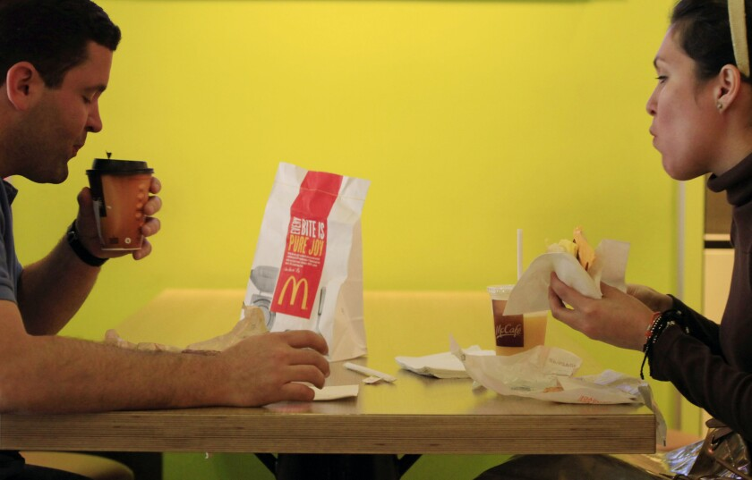 Analysts say breakfast is the only area with big growth potential in the fast-food industry, prompting chains to increase coffee offerings and other morning items. Above, Carlos Gonzalez and Elsa Guzman eat breakfast at a McDonald's restaurant in New York in 2012.