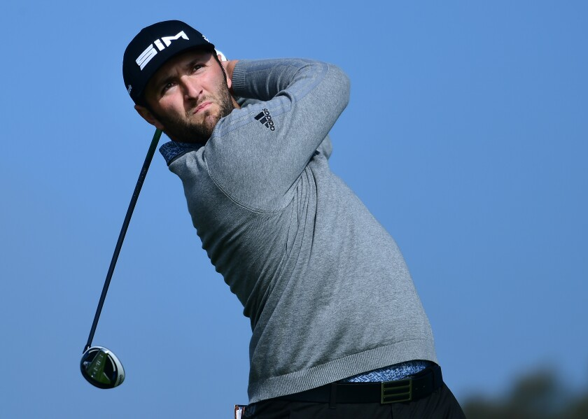 Jon Rahm tees off on the South Course at Torrey Pines in the third round of the Farmers Insurance Open on Jan. 25, 2020.