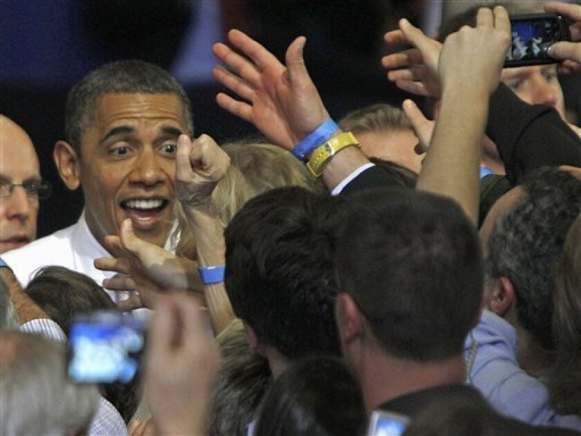 President  Barack Obama greets the crowd in Burlington, Vt., Friday, March 30, 2012, The president was in Vermont on a quick campaign swing that is going to include a series of fundraisers that are expected to draw more than 4,500 people.(AP Photo/Toby Talbot)