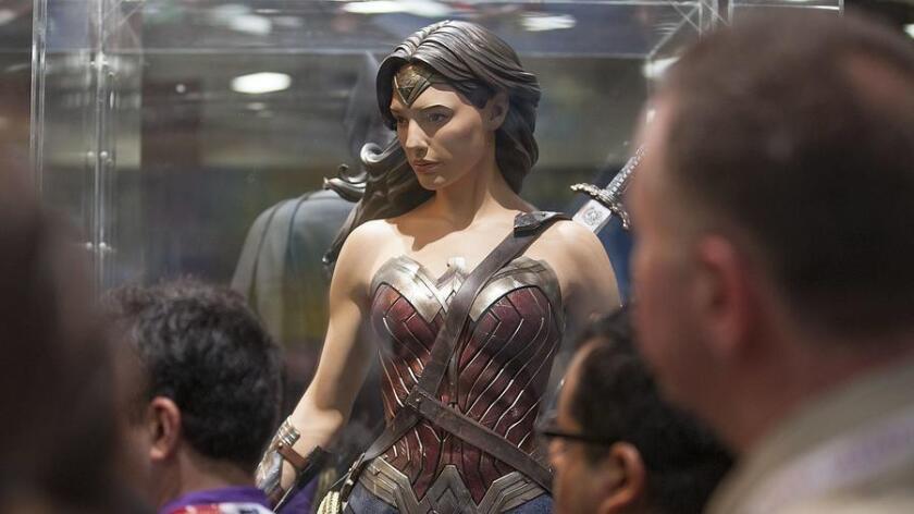 SAN DIEGO, CALIF. -- WEDNESDAY, JULY 8, 2015: Fans take in the new Wonder Woman costume at Comic-Con in San Diego, Calif., on July 8, 2015. (Brian van der Brug / Los Angeles Times) (Brian van der Brug)