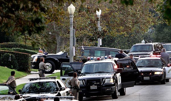 The presidential limousine pulls into the driveway of producer James Lassiter for one of two fundraising events in Los Angeles.