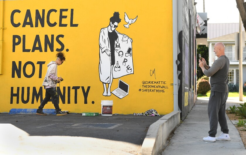 """A mural in West Hollywood reads: """"Cancel plans. Not humanity."""""""