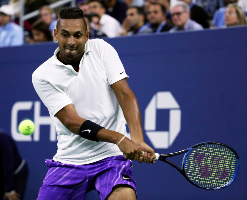 Nick Kyrgios returns to Steve Johnson on the second day of the US Open Tennis Championships on Tuesday in New York.