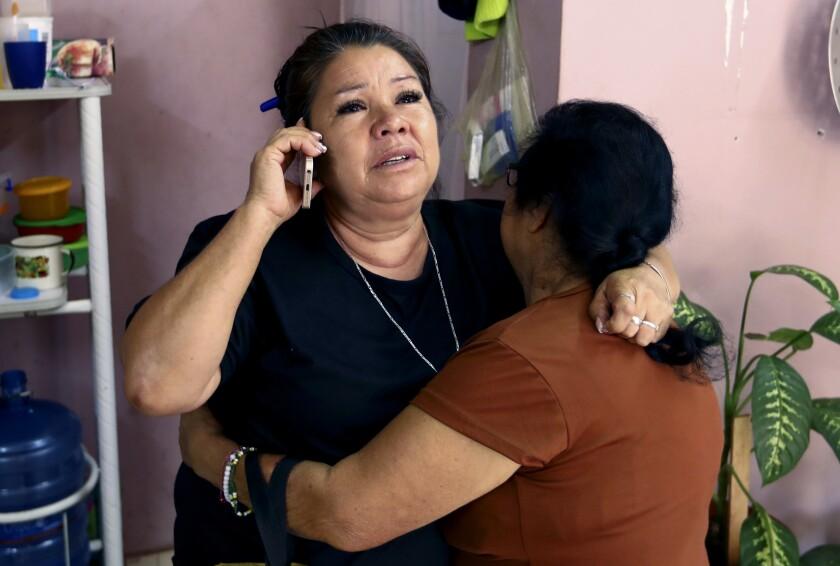 Rosa Alba Santoyo Soria is conforted by a friend.