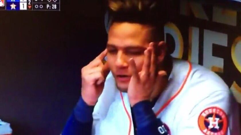 Astros first baseman Yuli Gurriel directs a racially charged gesture at Dodgers pitcher Yu Darvish, who is of Japanese and Iranian descent, after hitting a home run off Darvish in Game 3 of the World Series on Friday.