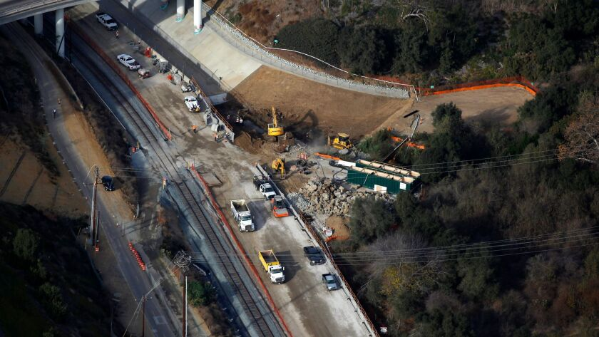 Construction continues on the Mid-Coast Trolley line along Interstate 5 on Friday, Dec. 8, 2017. The line will connect downtown San Diego to UC San Diego and UTC. (Photo by K.C. Alfred/The San Diego Union-Tribune)