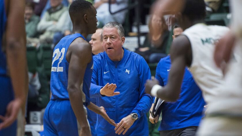 Air Force coach Dave Pilipovich encourages guard Pervis Louder during a timeout in the team's NCAA c
