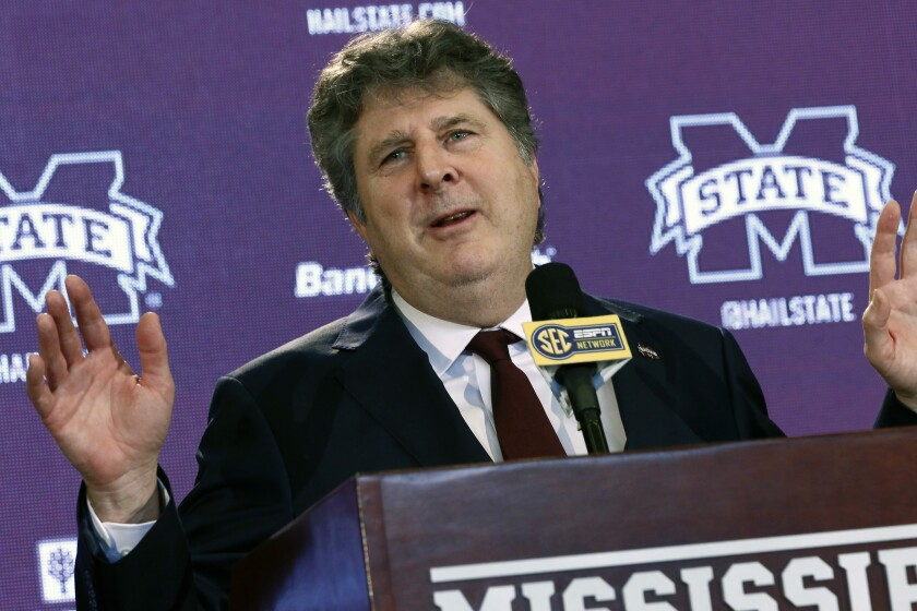 FILE - In this Jan. 10, 2020, file photo, New Mississippi State NCAA college football head coach Mike Leach speaks at a news conference in Starkville, Miss., after being officially introduced as the head coach. Mississippi State's Mike Leach and Mississippi's Lane Kiffin brought big names and offensive pedigrees to the Magnolia State. But they drew huge challenges for their debuts, with the Bulldogs visiting defending national champion and No. 6 LSU and the Rebels hosting No. 5 Florida. (AP Photo/Rogelio V. Solis, File)