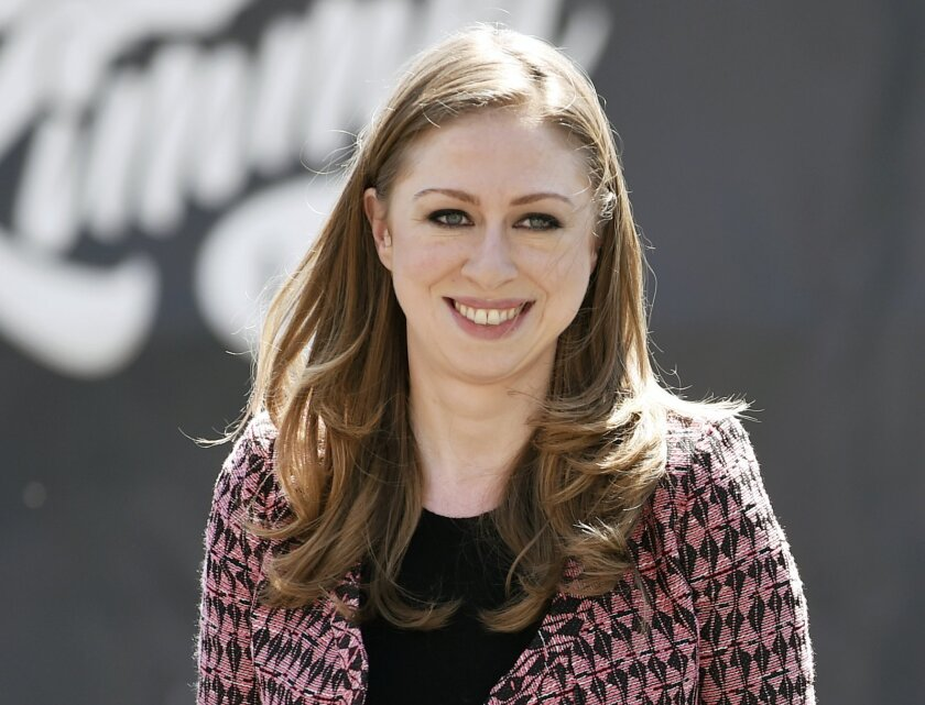 "FILE - In this March 23, 2015 file photo, Chelsea Clinton, vice chair of the Clinton Foundation, arrives at the launch of ServiceNation's ""Serve A Year"" campaign in Los Angeles. Clinton has a deal with Penguin Young Readers for ""It's Your World: Get Informed, Get Inspired & Get Going!"" the publisher announced Wednesday, May 20. The book aims to ""inform and inspire"" young people to ""change the world"" and will cover a range of issues from poverty to gender equality, according to Penguin. Publication is scheduled for September 15. (Photo by Chris Pizzello/Invision/AP, File)"