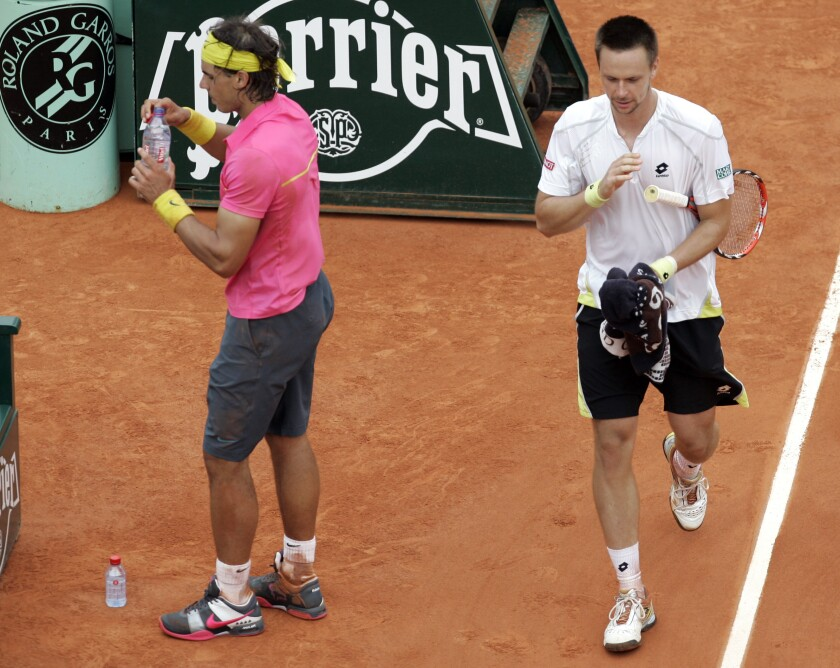 FILE - In this May 31, 2009, file photo, Sweden's Robin Soderling, right, and defending champion Spain's Rafael Nadal walk back to their seats during their fourth round match of the French Open tennis tournament at the Roland Garros stadium in Paris. Soderling won 6-2, 6-7 (2), 6-4, 7-6 (2). It wasn't just that Nadal was unbeaten through 31 matches at the French Open and considered a lock to become the first man with five consecutive titles there. It's also that Soderling never had been past the second round at any major.(AP Photo/Christophe Ena, File)
