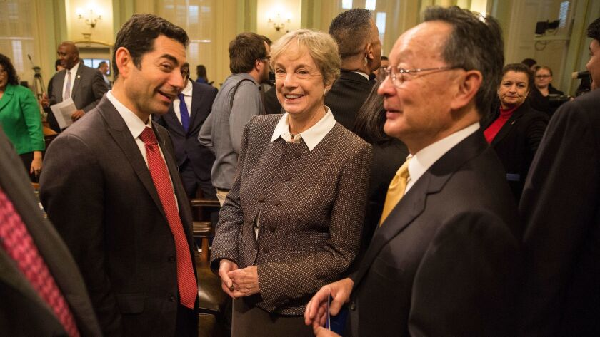 California Supreme Court Justice Mariano-Florentino Cuellar, left, with former Justice Kathryn Werdegar and Justice Ming Chin at Gov. Jerry Brown's State of the State speech on Jan. 21, 2016.