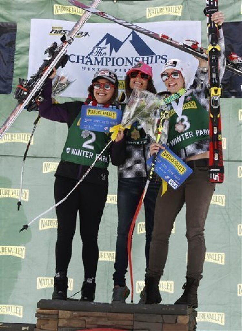 Winner Julia Mancuso, center, is flanked by second-place finisher Leanne Smith, left, and third-place finisher Laurenne Ross, right, as they celebrate of the podium after the women's super-G skiing event during the U.S. Alpine Championships, Friday, March 30, 2012, in Winter Park, Colo. (AP Photo/J