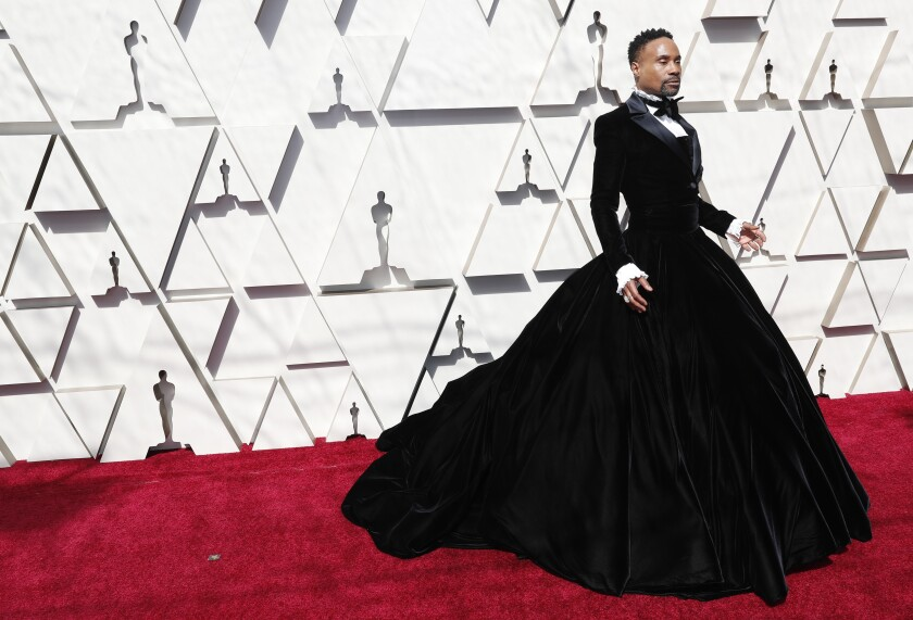 Billy Porter on the Oscars red carpet in an outfit that is tuxedo meets ball gown.