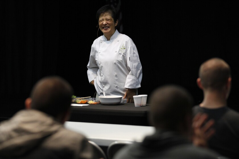 Chef Clara Kong smiles as she wraps up a brief primer on Korean food for LAPD officers attending a daylong seminar on Korean culture at the Korean Cultural Center.
