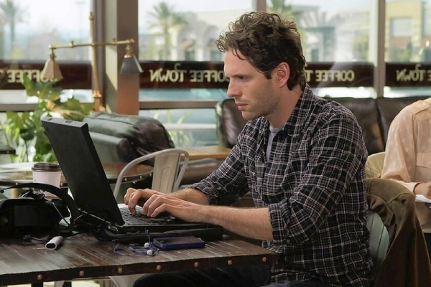 """Coffee Town ""star Glenn Howerton at work from his ""office"" in a scene from the movie."
