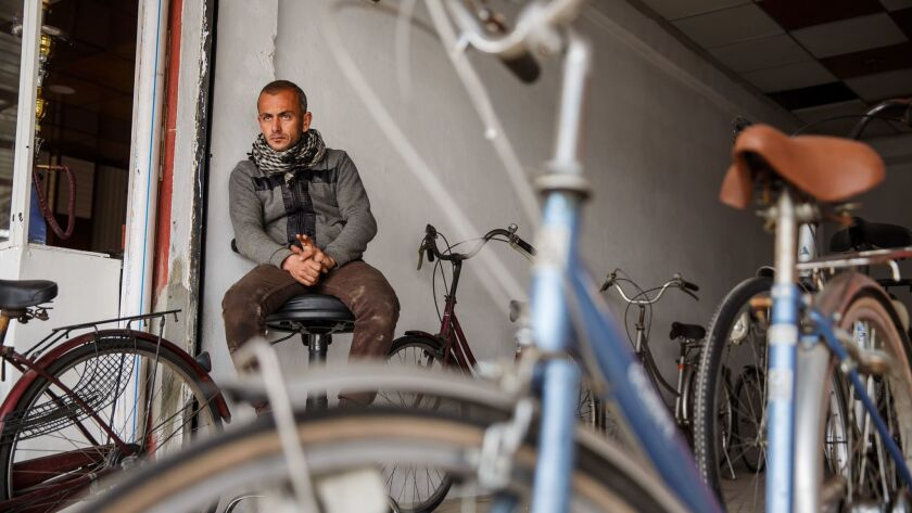 Mohammed Sabah Yehia, 32, sits in his new bicycle store in east Mosul.