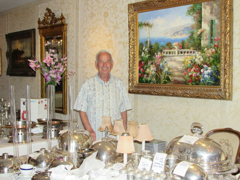 Maitre D restaurateur Louis Zalesjak poses with closing-sale items in the dining establishment he has owned and operated in La Jolla for the past 32 years.