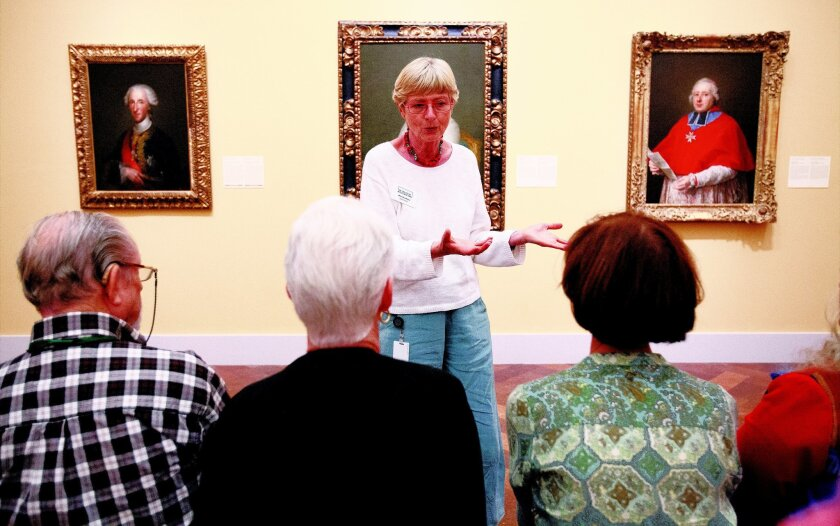 "At the San Diego Museum of Art, docent Monika Hseu leads a small group on the ""Memories at the 