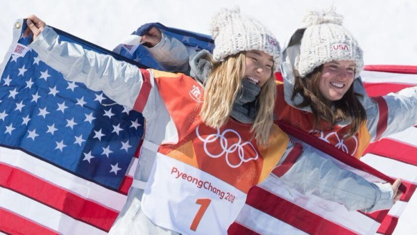 U.S. teammates Chloe Kim, left, and Arielle Gold celebrate after their gold and bronze snowboarding victories Feb. 13 at the Winter Olympics in Pyeongchang, South Korea.