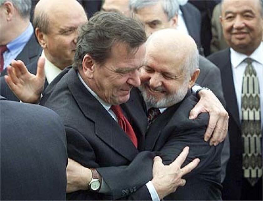 German Chancellor Gerhard Schroeder and Rome delegation leader Abdul Sattar Sirat.